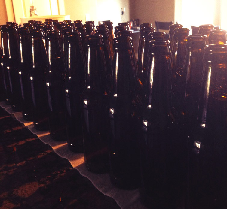48 empty bottles that will soon be filled with Irish Red Ale.