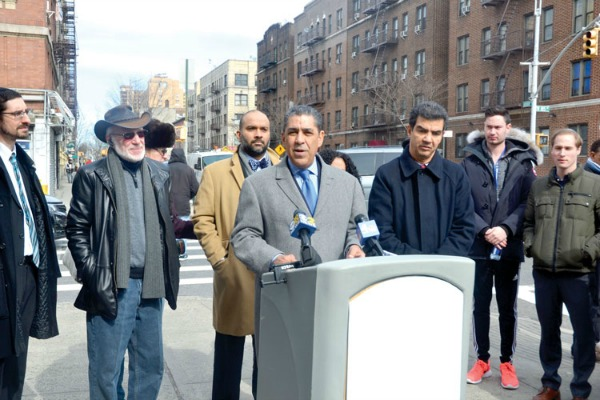 Sen. Adriano Espaillat (center) held a press conference on the hate crime investigation.