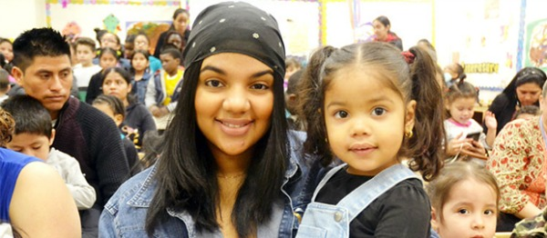 """""""It's been very rewarding,"""" said Stephanie Batista (left) with her daughter Sarayi."""