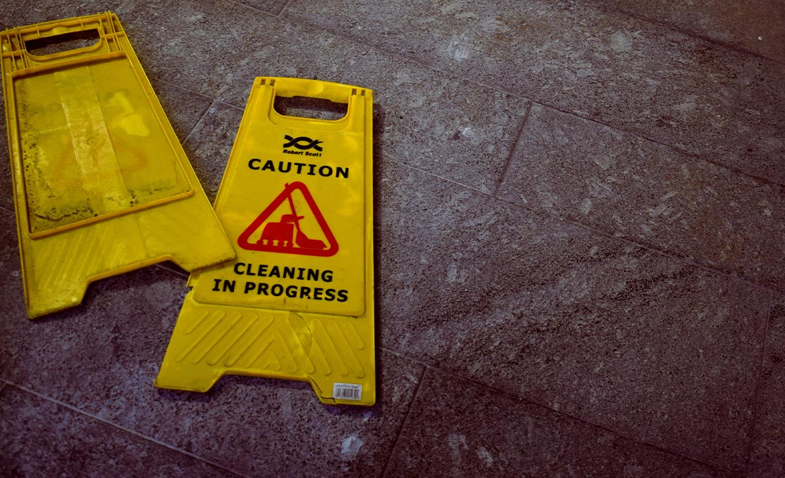 broken caution sign because of workplace injury