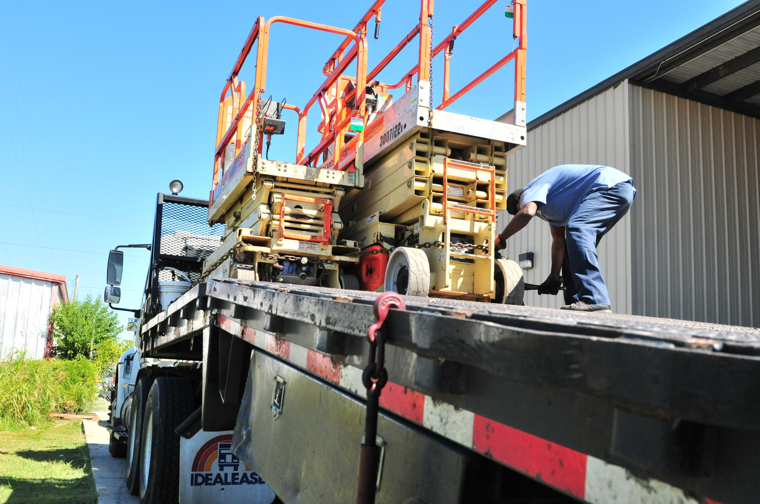 Rental equipment being loaded on truck