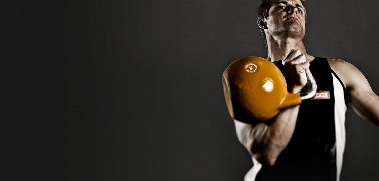 man exercising with kettle bells
