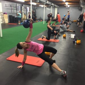 People working out with kettle bells turkish get ups