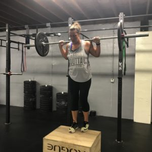 Woman with weights box climbing