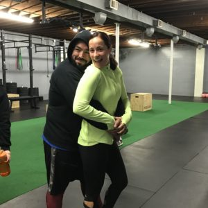 Man and woman hugging in gym