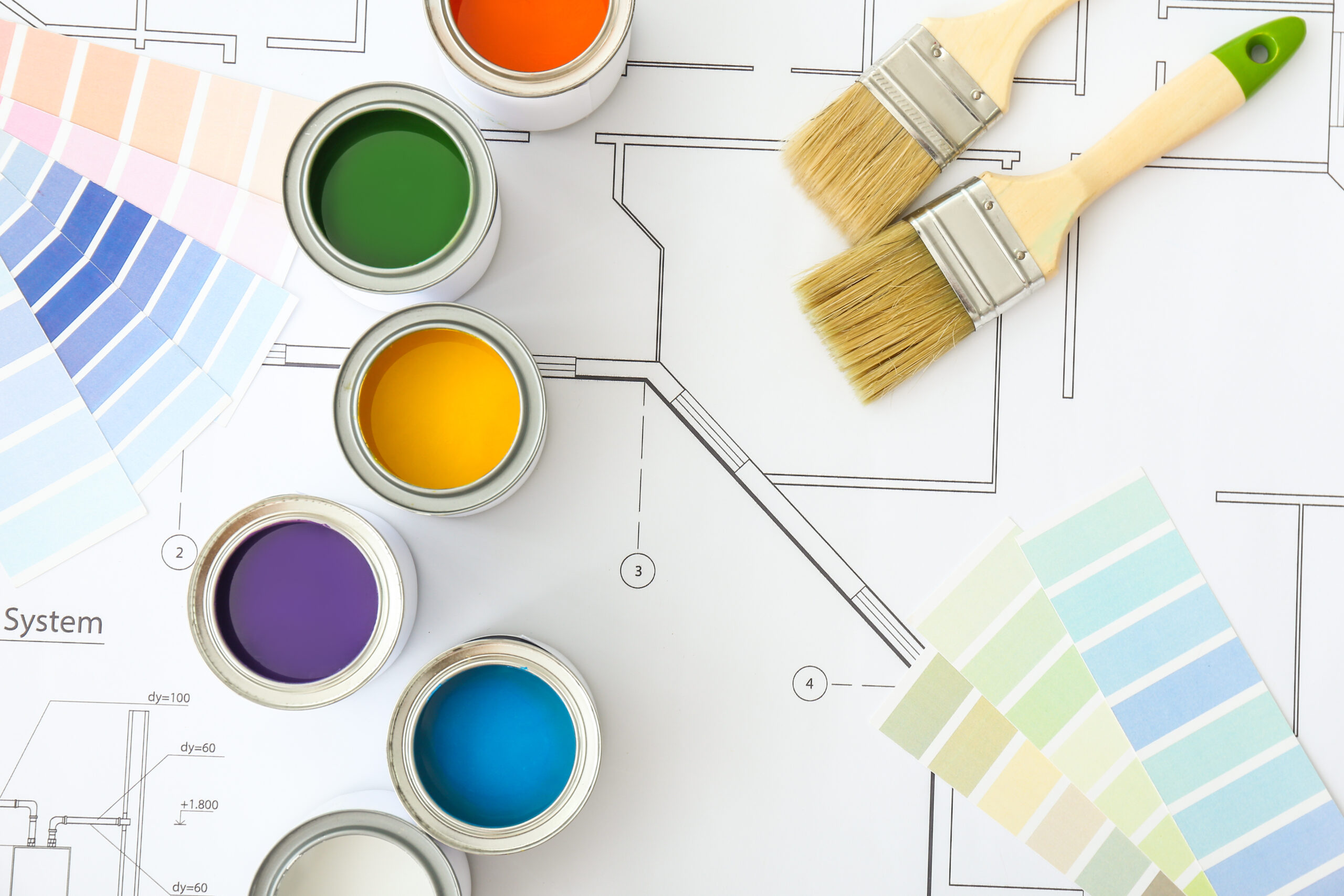 Cans of paint with brushes, palette samples and house plan