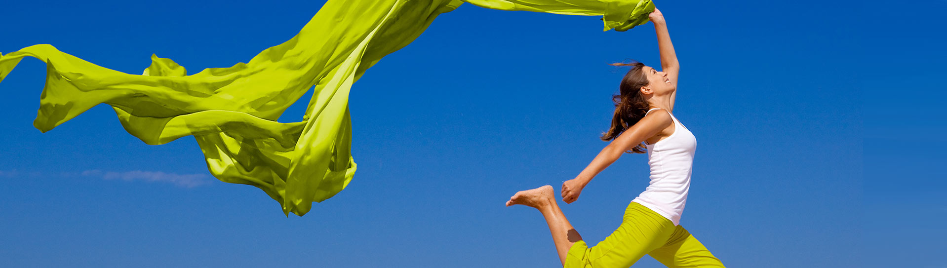 lady jumping in air happy with long scarf