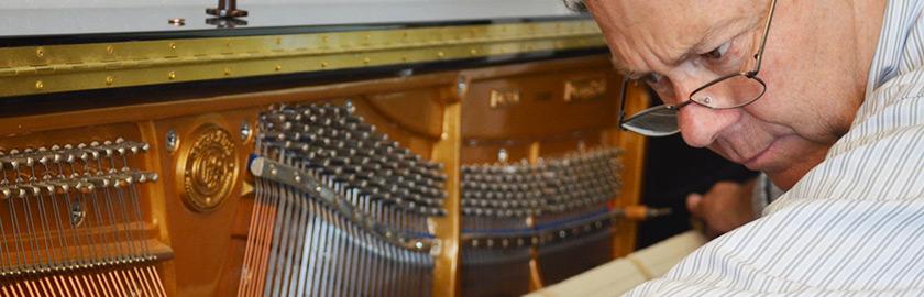 Randy Black servicing upright piano