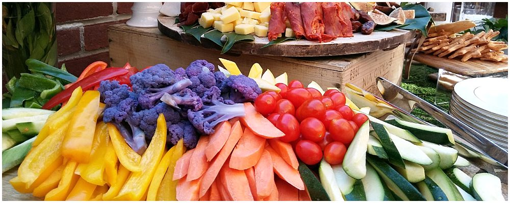 colorful rainbow display of raw vegetable sticks