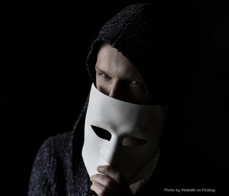 Image of sinister looking man behind white mask is narcissistic abuser