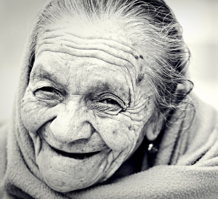Black and White photo of elderly woman smiling