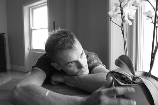 Black and white image of man with self inflicted guilt