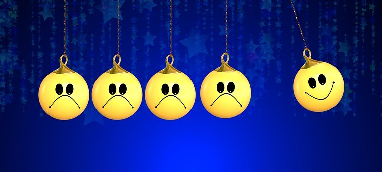 four yellow sad emoji next to one yellow happy emoji ornament pendant illustration