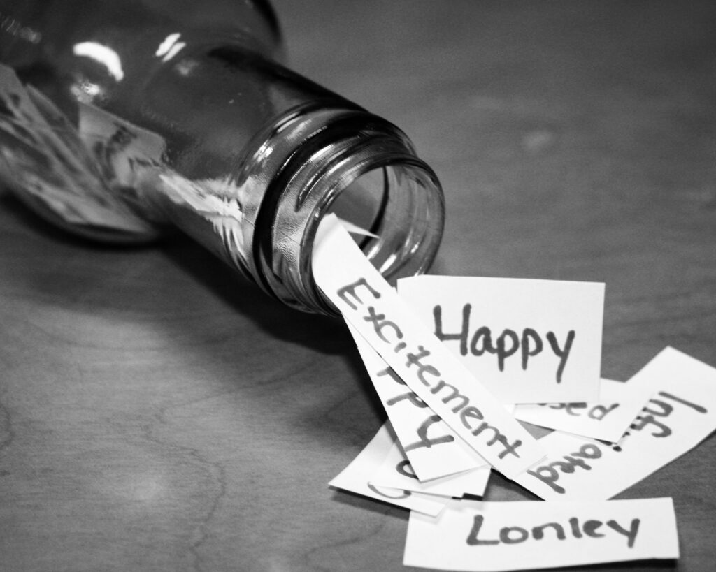 Image of bottle with unexpressed emotions written on slips of paper