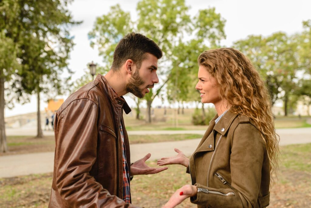 Man and woman in brown leather jackets using relationship conflict management