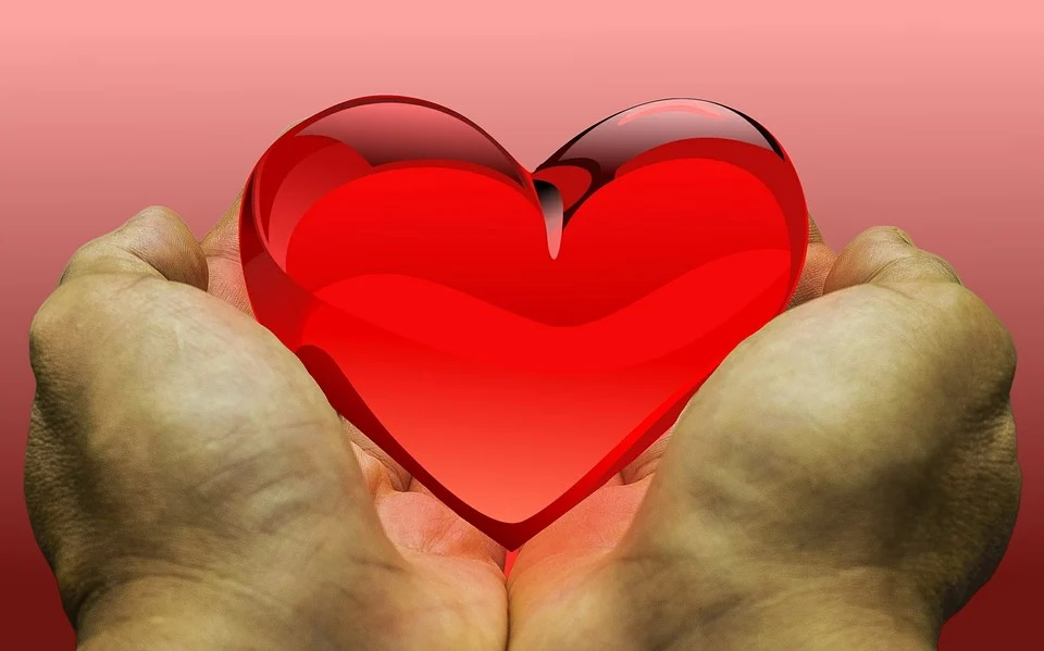 Two hands holding red heart represents grateful heart