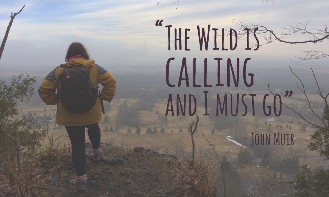 Olivia hiking with quote: The wild is calling and I must go.