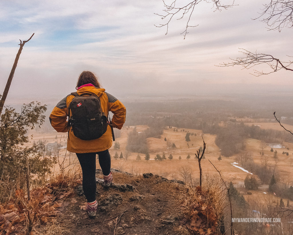 Overlooking cliff hiking in Ontario | With the powerful device in your pocket you can take incredible photos of your travels. Here is the ultimate guide to smartphone travel photography. | My Wandering Voyage travel blog #travel #photography #tips #travelphotography #smartphonephotography