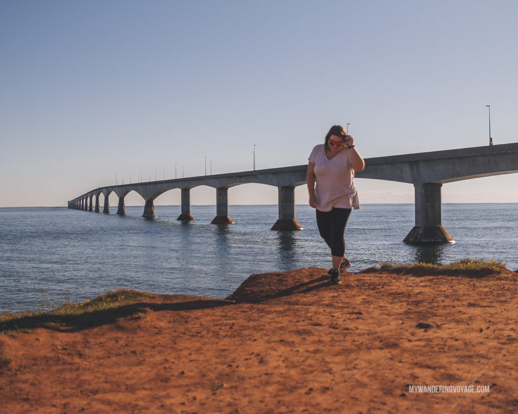Confederation Bridge and red cliffs in PEI | When road trip season hits, don't be caught unprepared. Make sure you have everything you need with this road trip packing list for a successful and enjoyable trip | My Wandering Voyage travel blog #travel #roadtrip #packing #USA #Canada