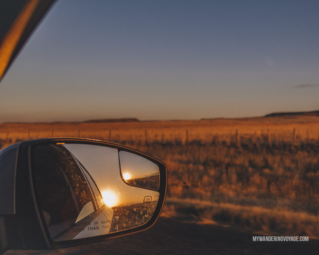 sunset in the car side mirror | When road trip season hits, don't be caught unprepared. Make sure you have everything you need with this road trip packing list for a successful and enjoyable trip | My Wandering Voyage travel blog #travel #roadtrip #packing #USA #Canada