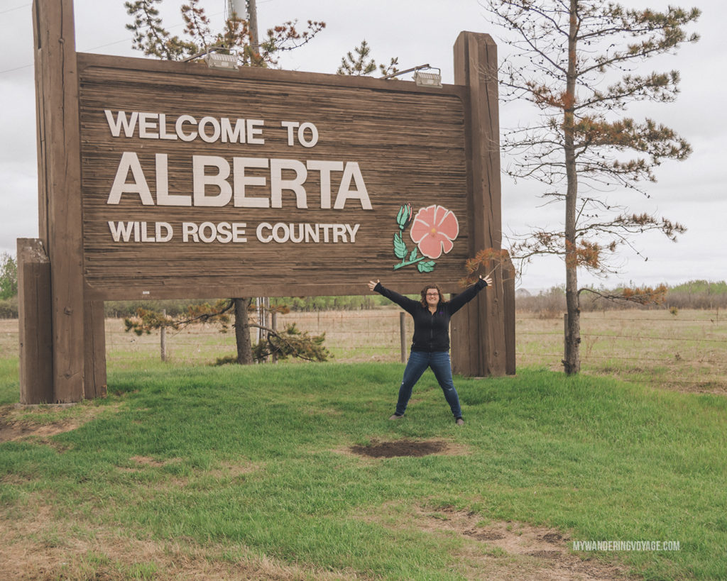 Welcome to Alberta road sign | When road trip season hits, don't be caught unprepared. Make sure you have everything you need with this road trip packing list for a successful and enjoyable trip | My Wandering Voyage travel blog #travel #roadtrip #packing #USA #Canada