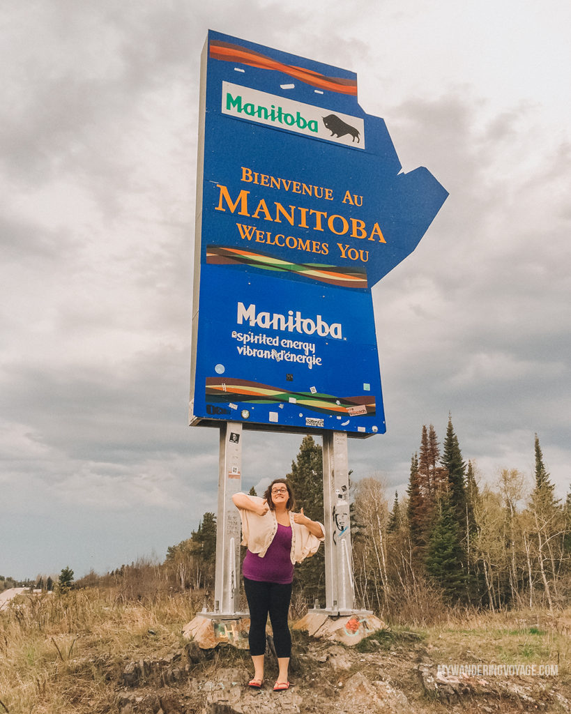 Welcome to Manitoba road sign | When road trip season hits, don't be caught unprepared. Make sure you have everything you need with this road trip packing list for a successful and enjoyable trip | My Wandering Voyage travel blog #travel #roadtrip #packing #USA #Canada