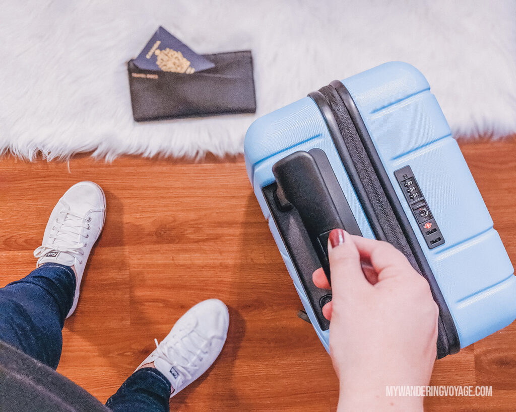 CHESTER suitcase from above with white shoes and passport | CHESTER luggage review for best carry on luggage | My Wandering Voyage Travel Blog