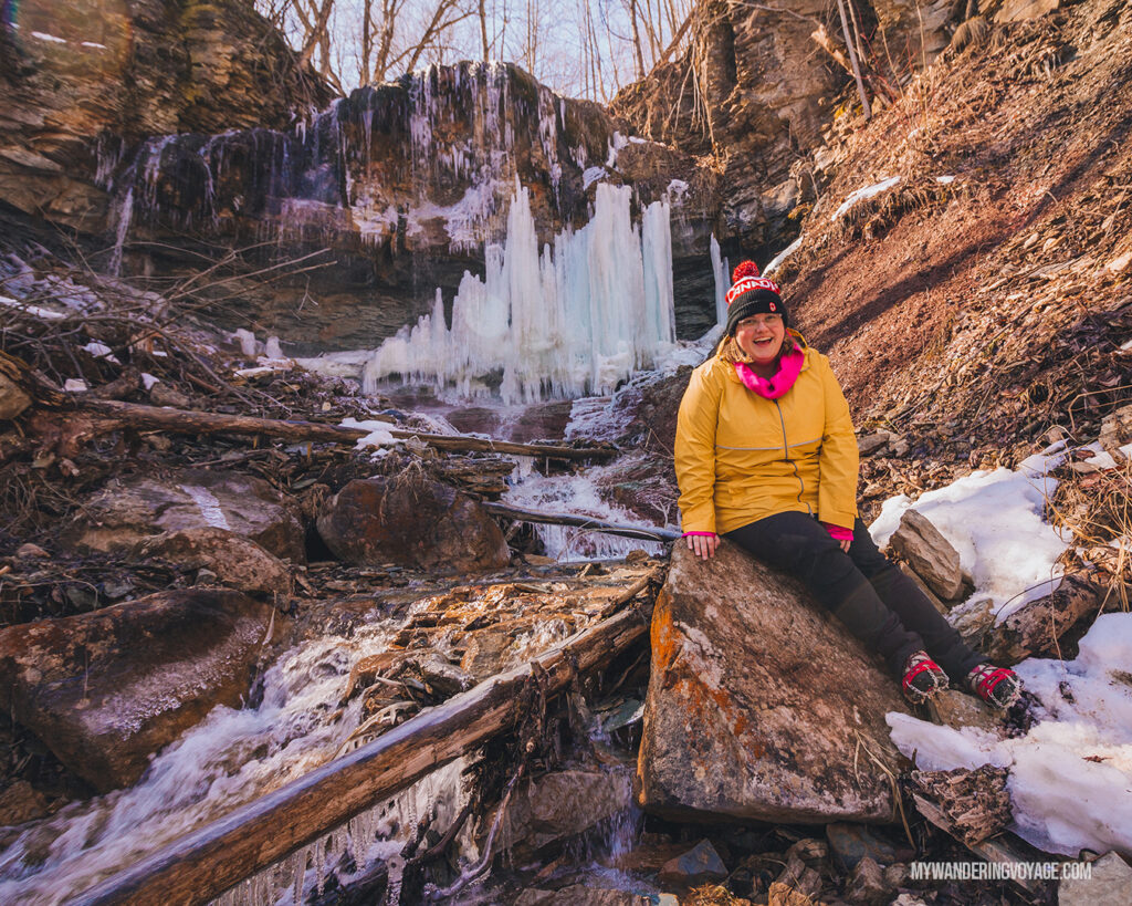 Woman and frozen waterfall | Hiking the Bruce Trail: 14 side trails to explore | My Wandering Voyage travel blog