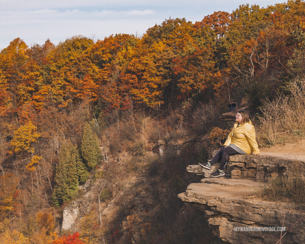 Woman sitting on Dundas Peak | Hiking the Bruce Trail: 14 side trails to explore | My Wandering Voyage travel blog