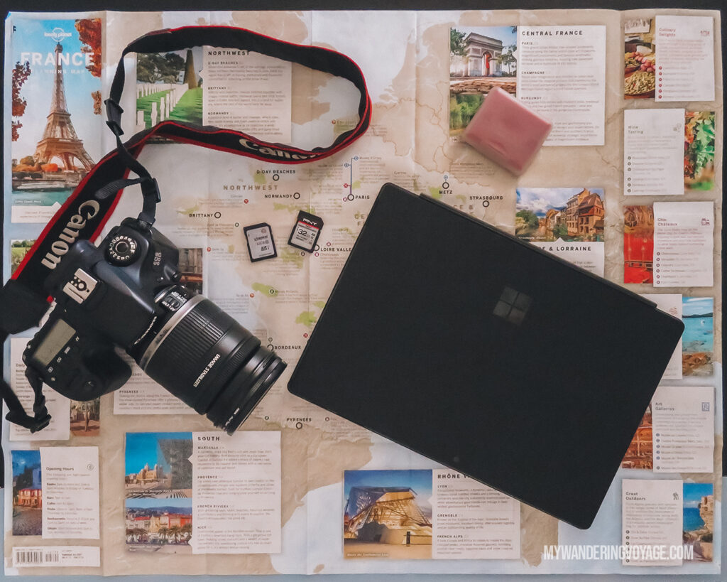Camera and Laptop with map | Best Way to Organize Your Travel Photos | My Wandering Voyage