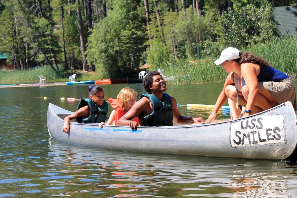 kids canoeing on Lake Vera