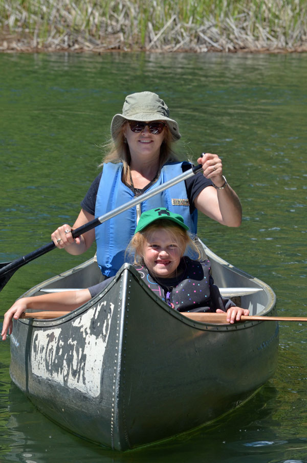 woman and child canoeing