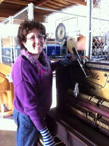 Lisa Weller servicing an upright