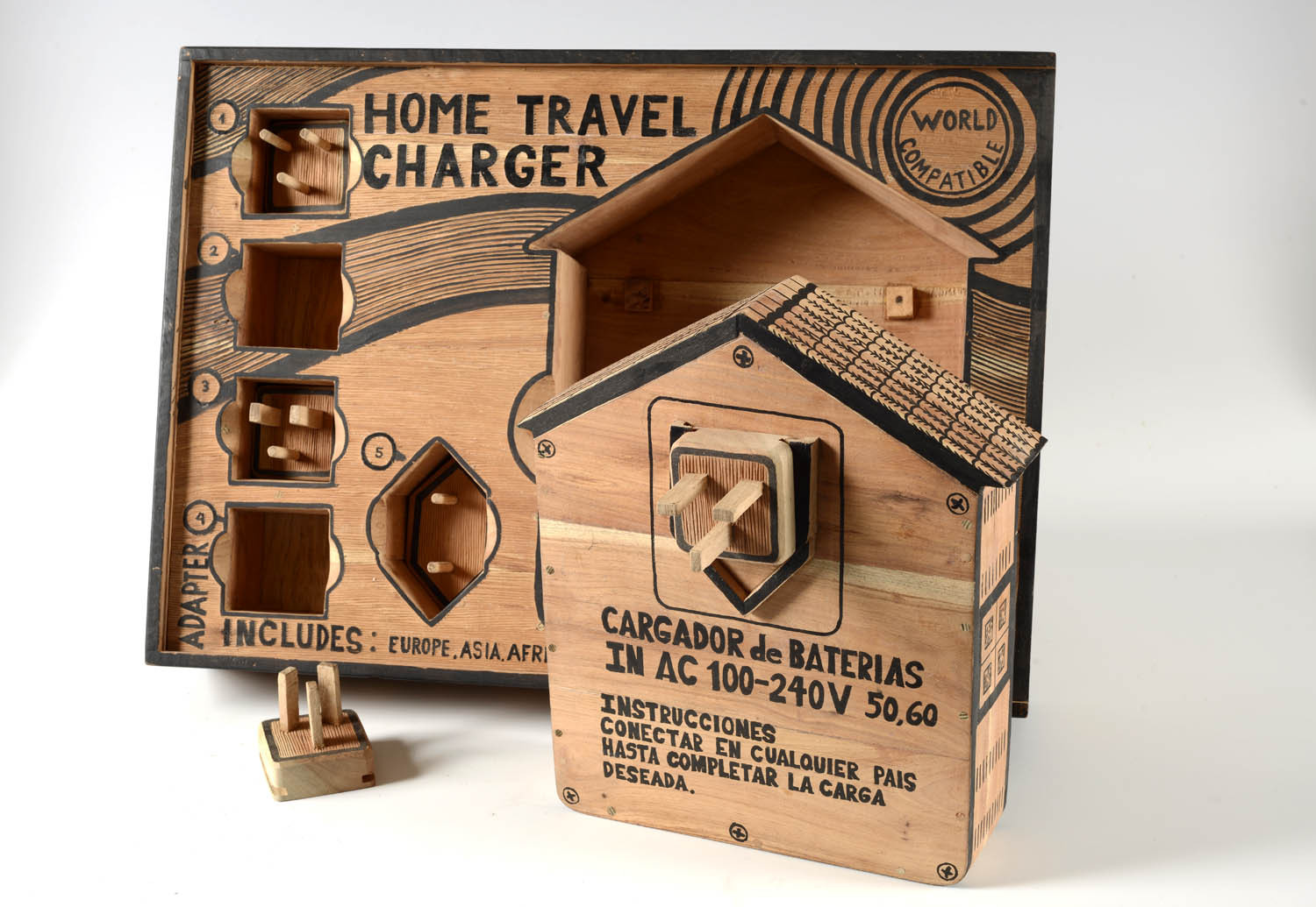 Abel Barroso_HOME TRAVEL CHARGER_Hand carved wood sculpture, woodcut_16 x 22 x 11 inches