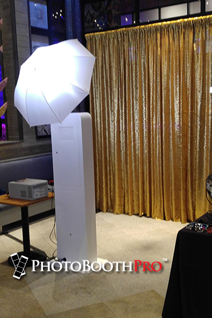 Photo Booth For Sale - Selfie Max Photo Kiosk at an event facing a Gold sequin backdrop