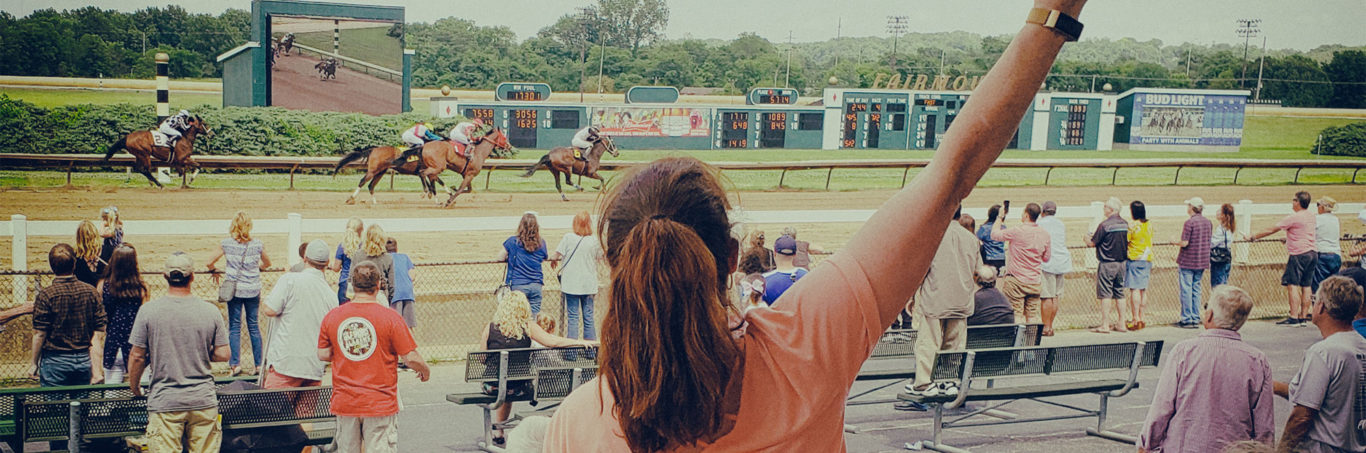 Women cheering at race track