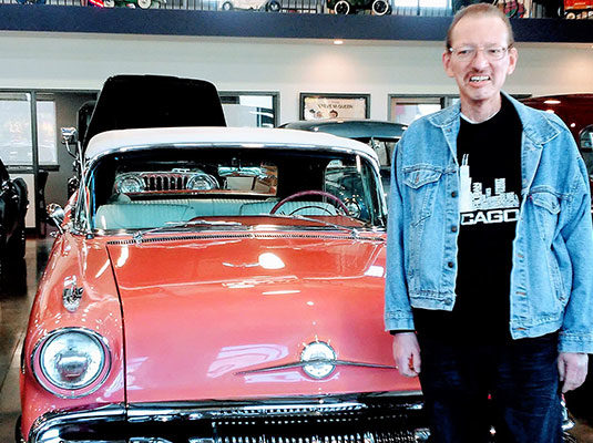 Jim with a vintage car