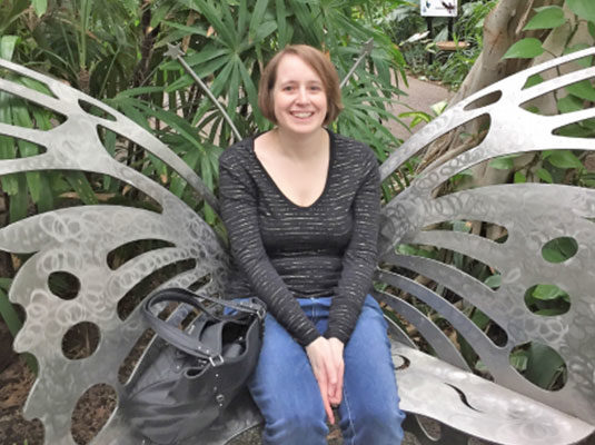 Melanie sitting on butterfly bench