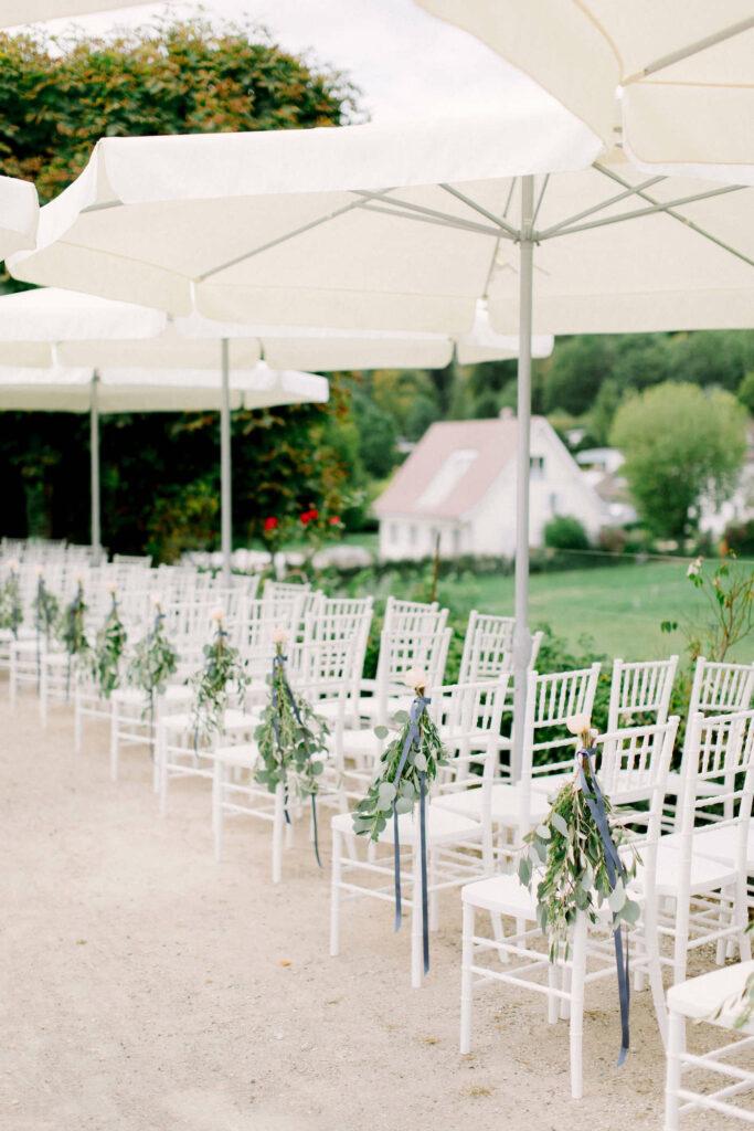 wedding ceremony umbrellas at waldegg castle