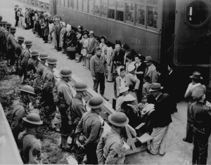 "(c) National Archives:  ""Persons of Japanese ancestry arrive at the Santa Anita Assembly Center from San Pedro. Evacuees lived at this center at the former Santa Anita race track before being moved inland to relocation centers. Clem Albers, Arcadia, CA, April 5, 1942. Photo No. 210-G-3B-414"""