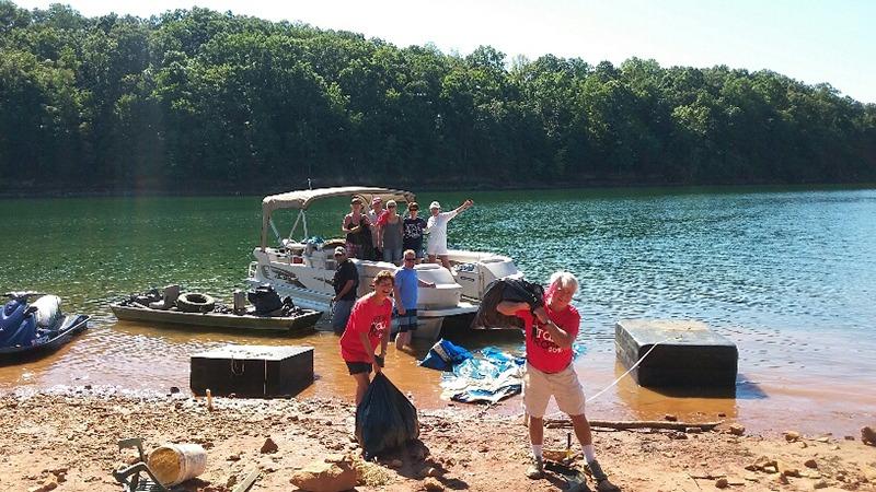 Volunteers bagging trash after shore sweep