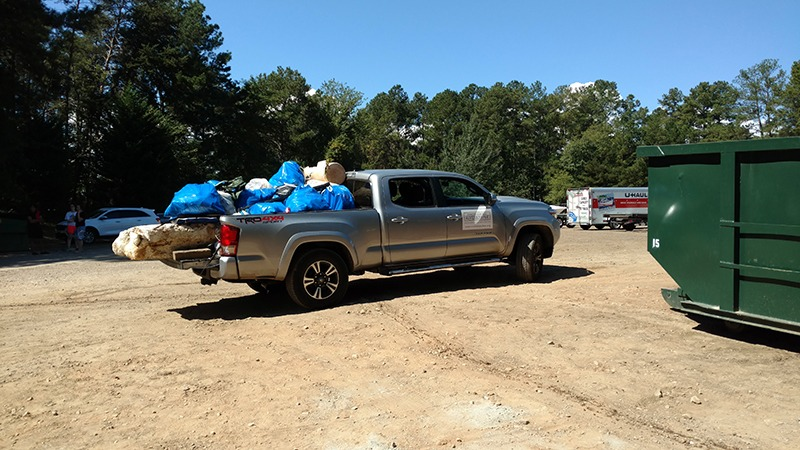 Truck loaded down with trash after shore sweet