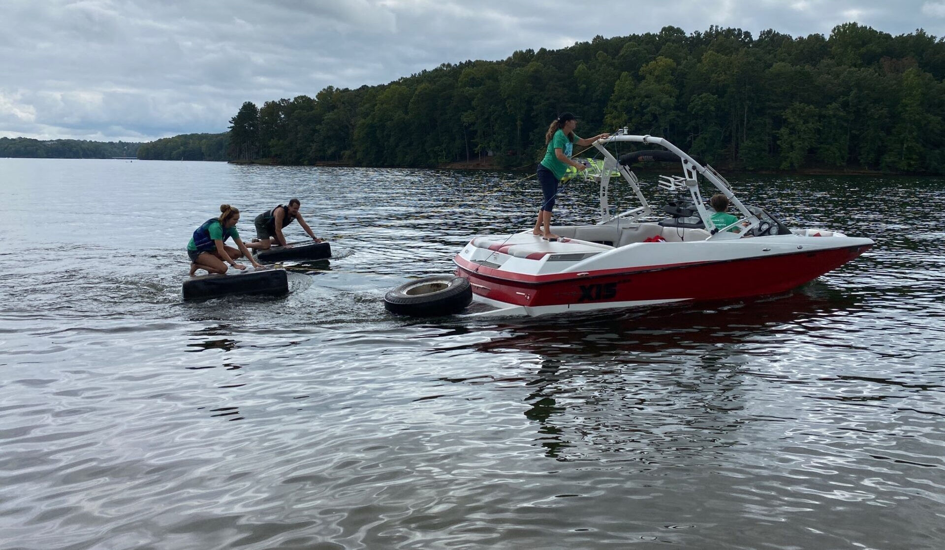 A boat tows trash collected from Shore Sweep