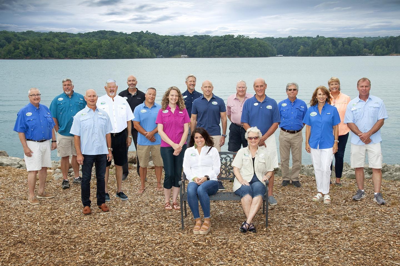 Board members posing in front of Lake Lanier