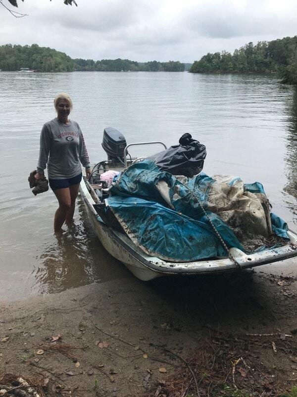 Shore Sweep volunteers bringing trash in on their boat