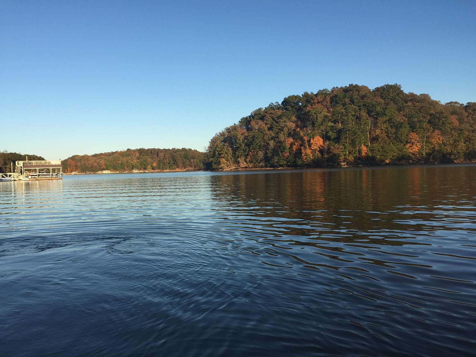 Lake Lanier with blue skies and a homeowner's dock