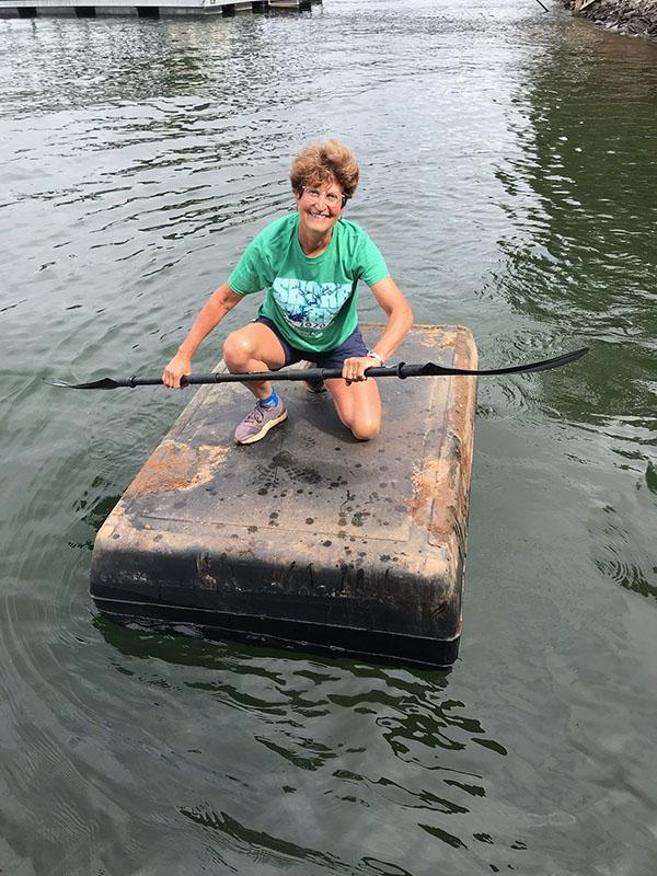 Shore Sweep Volunteers paddling debris to the shore