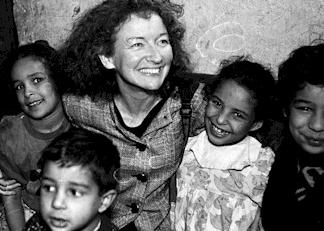 Kathy Kelly with children in Iraq