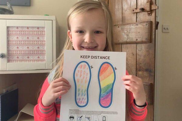 Child-with-footprint-art
