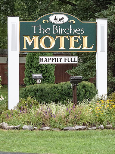 the birches motel sign